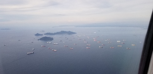 Flying over the ships waiting to transit the Panama Canal